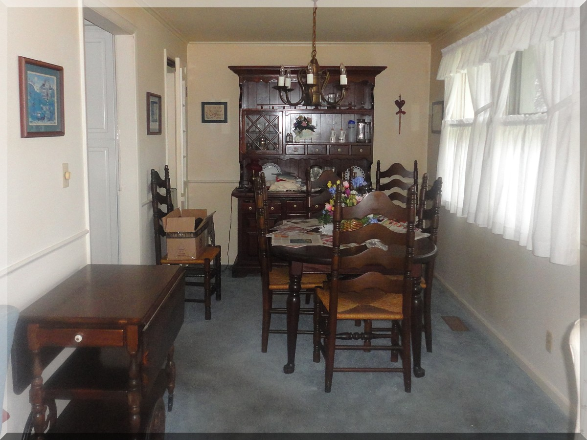 Andrews Estate Service Household Liquidation Specialists Dining Room North Wall Cluttered
